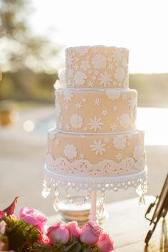 Yellow cake with white floral fondent: http://www.stylemepretty.com/2014/12/01/romantic-ranch-wedding-in-kendalia/   Photography: Archetype - http://archetypestudioinc.com/