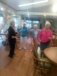 Stanley Total Living residents dancing to Unos, Dos y Tres with Branch Manager Michelle Osborne and Branch Assistant Carmen Vazquez.