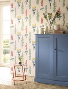 A joyous, contemporary take on botanical prints, this naively stencilled pattern of foliage and wild meadow flowers.