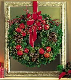 hang the wreath in a frame then sit it on the mantle save making a hole in the wall and a whole lot more artistic. wreath with apples and pinecones
