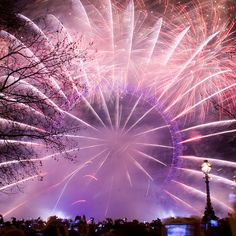 Fireworks are fired from the EDF Energy London Eye to mark the start of London's Olympic Year.  Thousands of revellers lined the streets of London to celebrate.London, UK. 1st January 2012. by Paul Brock Photography, via Flickr