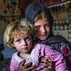 Two beautiful children from Bakhtiari tribe, Iran. Colored eyes and blond hair…