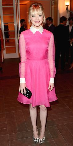 Emma Stone turned heads at the Women in Hollywood fete in a bright dress and embellished clutch from Valentino, stacked gold rings and houndstooth Ferragamo pumps.