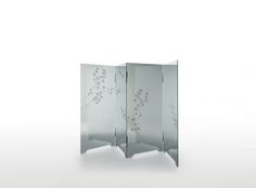 HAIKU design Jean-Marie Massaud | Screen composed of four doors in 8 mm. thick tempered reflective smoked glass, decorated with images of nature. The low relief decoration, achieved through a special glass engraving technique, gives depth and threedimensionality to the featured images. The hinges, glued to the glass, are in black chromiumplated metal.