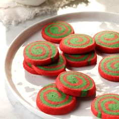 Red & Green Pinwheels Recipe -My mom used to make these cookies every Christmas, and I still love them. They are so colorful. You can use different food coloring for different seasons.—Jill Heatwole, Pittsville, Maryland