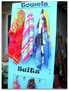 swimsuit towel door - so smart!  It's cute, and it keeps the wet suits and towels off the floor (and off the backs of chairs)!