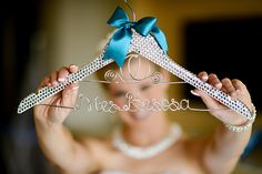 We adore this Walt Disney World bride's personalized dress hanger with Cinderella's Coach