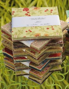 Charm squares. We love to admire their colors, stack them in piles, imagine them as quilts. How can you get more of them? Well, visiting your local quilt shop is a good first step (as though you needed to be told). And you can always cut your own. But if you want more charm squares …