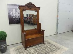 Large Victorian quarter cut Oak Hall stand. This tall piece of furniture with a mirror hooks for hats and other articles of clothing and a seat which lifts open having a compartment for storage is in beautiful refinished condition ready to look amazing in your home or office