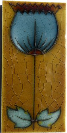 Simple in the Arts & Crafts style tubed Art Nouveau from Henry Richards c1906, tile reference 1108 volume 2.