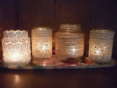Crystal i really like this. esp. the left one! This is a DIY project that is fun and inexpensive. Pick your favorite lace pattern and twine, then glue them to jars with clear crafter's glue. Add a tea candle and you have created a warm lighting for your reception!