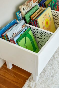 Make This Easy DIY Book Bin for Pretty Playroom Storage Make This Easy DIY Book Bin for Pretty Playroom Storage diy white storage bin with childrens books<br> Complete with a wallpapered interior! Playroom Organization, Organizing Kids Books, Playroom Decor, Kids Playroom Storage, Children Storage, Kid Playroom, Diy Childrens Storage, Girls Room Storage, Children Playroom