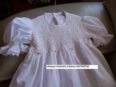 soft cotton pearls and roses 85cm long smocked gown, 0427820744 place your orders 5 weeks prior to when needed $160