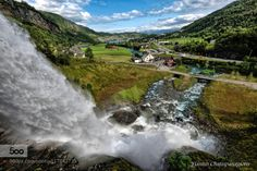 Following the waterfall by yiannischatzipanagiotis  Norway clouds river sky summer sunset valley water waterfall Following the waterfall yiannischatzipa