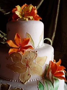 Wedding Cake with Orange Sugar Paste Lilies and Hand Painted Relief Lilies...