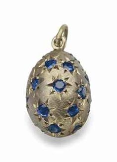 A JEWELED GOLD PENDANT EGG MARKED FABERGÉ, ST. PETERSBURG, 1890  Ovoid, the gold body engraved with wavy pattern and starbursts inset with hardstones, with suspension loop.
