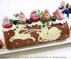 Beautiful Christmas Cake Roll Chocolate/White Chocolate with Berries.
