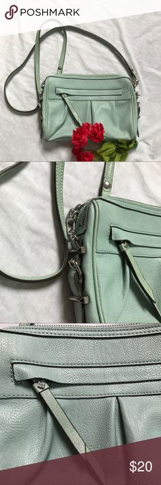 Light Seafoam Green Crossbody Simply Vera His is a subtle seafoam color, very pastel, with silver colored hardware from Simply Vera by Vera Wang. The purse is in really excellent condition, no damage or major flaws.   |✅20% Off Bundles| |✅Questions Welcomed| |✅Reasonable Offers| |⛔️Trades| |⛔️Offline Transactions| |Thrift is Sexy 💋👠 Simply Vera Vera Wang Bags