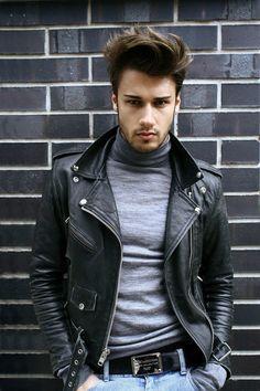 Leather biker jacket. Cashemere turtleneck and blue jeans.