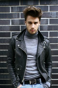 Leather biker jacket. Cashemere turtleneck and blue jeans.