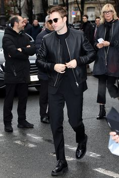 WHO: Robert Pattinson  WHAT: Dior Homme WHERE: At the the Dior Homme Fall 2018 show during Paris Fashion Week  WHEN: January 20th, 2018  WHY: No one pulls off the Dior Homme uniform of all-black and a few badass accessories quite as convincingly as Robert Pattinson.