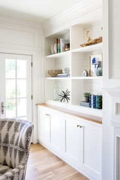 arranging white coastal style shelves with accessories