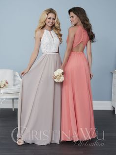 A lace top gown with a high neckline and a thin slit that travels down the front of the bust to the satin waistband, sheer until it meets the hidden sweetheart neckline lining under the lace. Complete with a full chiffon skirt and button-up back that forms a keyhole between the buttons and the zipper …