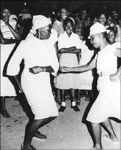Two women dance 'bruckins' - the History of Jamaica Festival.
