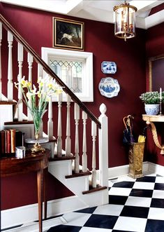 I like this deep red with the black and white tile and the blue accents but it's too much to do in a little bathroom-right?