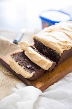 This double chocolate quick bread is decadent, moist and fudgy! It is absolutely irresistible when topped with a creamy peanut butter frosting!