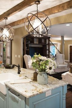 I really love old beams, and the robins egg blue island.... And the granite top. Rustic, yet modern decor resulting in a beautiful home.