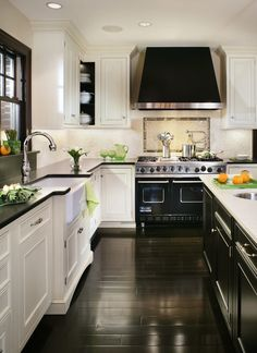 A large range hood brings your eye to the ceiling, making this kitchen appear taller than it actually is