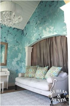Venetian plaster. Blended three colors, starting with navy at the top, turquoise in the middle, and a pale ice blue at the bottom. Job used Sherwin William's Faux Impressions Venetian Plaster. They opted for a flat finish for a more rustic feel so skipped the polishing step. Burlap and Denim.