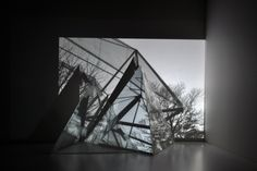 Studio test, video projection over tetrahedron maquettes