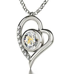 "925 Silver Zodiac Heart Pendant Sagittarius Necklace Inscribed in 24k Gold on Clear Swarovski Crystal, 18"". Silver heart shaped necklace with Sagittarius star sign and symbol intricately inscribed in 24k Gold using innovative technology onto a brilliant round cut crystal colored Swarovski crystal. 0.3 inches, 8mm. A 925 sterling silver, high quality, Italian chain measuring 18 inches, 45cm, elegantly suspends from the romantic heart pendant, 0.8x0.6 inches, 2x1.5cm. Enhanced with 8 crystal…"