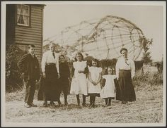 The Great War, Great Brittain. Mrs. Lewis and family posing in front of a zeppelin brought down in september 1916