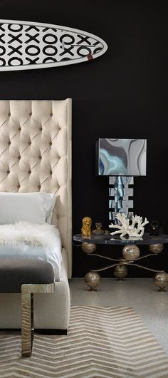 Stunning master bedroom with tufted headboard and gorgeous modern over the bed detail by Brown Davis Interiors