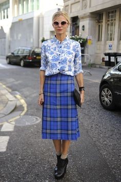 At Kinder Aggugini's S/S 13 show in London in Sept., Laura Bailey experimented with clashing prints--Topshop's Toile Print Shirt ($76) and a vintage tartan skirt. The chic look, accented with Stella McCartney Round Sunglasses ($225) in Soft Pink, a Laura Bailey for Radley clutch, and Camilla Skovgaard boots, works as both pieces belong in the same color family.