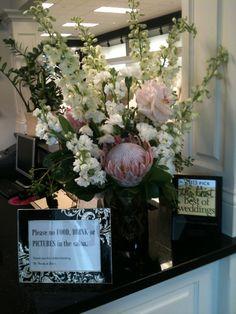 King protea, white delphinium, stock, carnations, blush peonies, hydrangea. Salon arrangment. #white floral arrangment