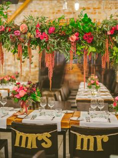 floral amaranthus chandelier - photo by Olive Photography http://ruffledblog.com/winter-garden-wedding-in-toronto #weddingideas #receptions #flowers