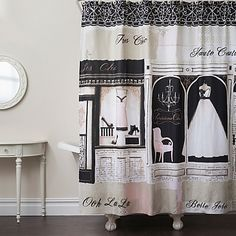 Ooh la la. Add a cute Parisian accent to your bathroom décor with the Parisienne Chic shower curtain. This fun shower curtain showcases a printed French boutique scene in shades of black, pink, and cream with bow and rhinestone trim.