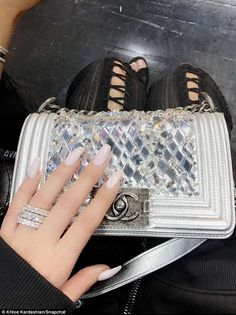Shine bright:But that was nothing compared to her handbag's price tag, as the star carried a just released silver with metallic embroidery Chanel handbag which retails at almost $9000. Not to mention the three stacked diamond rings she wears on THAT finger