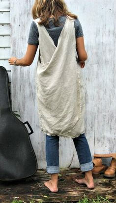 Love this linen apron and how it comes in slightly at the hem.