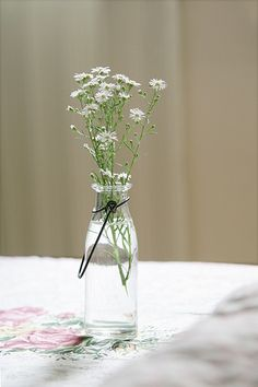 A very simple, cheap option for your reception tables. Divine.