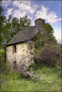 Aged with beaty - an Old abandoned stone cottage being taken over by vegetation