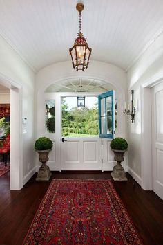 17 Dutch Doors We're Absolutely Loving | We're head over heels for these divided doors. You've heard that the eyes are the windows to the soul. Well, in that sense, doors are the windows to the soul of the home.
