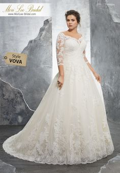 Style VONA Kosette Wedding Dress Classic Tulle Bridal Ball Gown with Frosted Alençon Lace Appliqués on and 3/4 Sleeves. A Zipper Back Closure Trimmed in Covered Buttons Completes the Look. Available in Three Lengths: 55″, 58″, 61″. Colors Available: White, Ivory, Ivory/Champagne