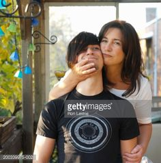 Stock Photo : Mother hugging teenage son (15-17), portrait