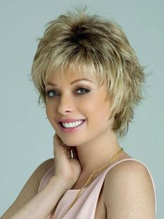 Find the Winter Wig by Rene of Paris Wigs. A short carefree style with flirtatious layers that are flattering and modern. Short Sassy Haircuts, Short Hairstyles For Thick Hair, Short Hair With Layers, Short Hair Cuts For Women, Curly Hair Styles, Layered Hairstyles, Sisterlocks, Undercut Hairstyles, Pixie Hairstyles
