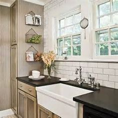 black counter, gray khaki beadboard and or paint and white shelving with dishes would be nice